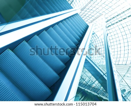 Wide angled view to perspective escalators stairway inside contemporary blue glass business centre, concept of successful career elevation