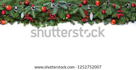 Wide arch shaped Christmas border isolated on white, composed of fresh fir branches and ornaments in red and silver #1252752007