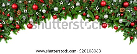 Wide arch shaped Christmas border isolated on white, composed of fresh fir branches and ornaments in red and silver #520108063