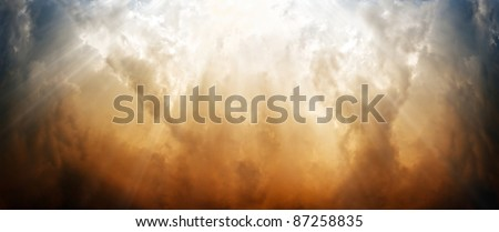 Wide background - dramatic sky, bright sun light from above