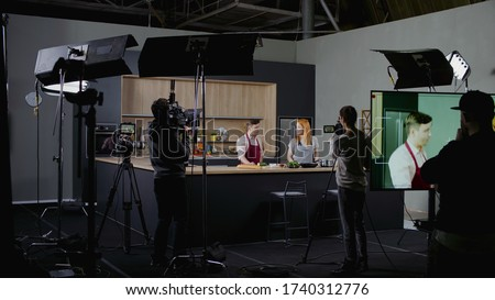 WIDE Behind the scenes of studio set, shooting TV television cooking show featuring celebrity chef, professional TV production Stock photo ©