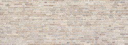 Wide Beige brick wall panoramic background or texture.
