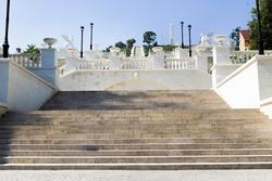 Wide concrete steps. Park landscape. Stone paved stairs in park. Kerch, Crimea.