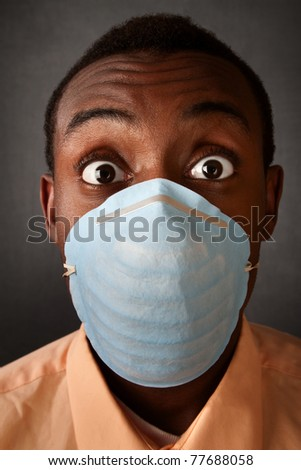 Wide-eyed Black man wearing a surgical mask