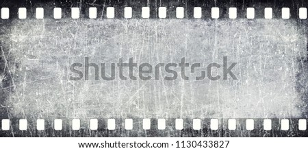 Wide filmstrip texture with scratches and grains