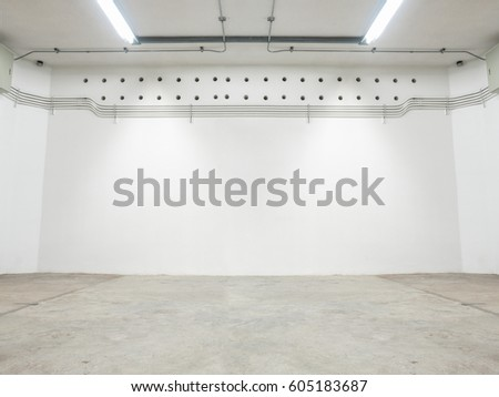 Wide high resolution shot of empty storage room with nice cement or concrete wall and washed cement floor. Background of wall and floor that has urban or industry look