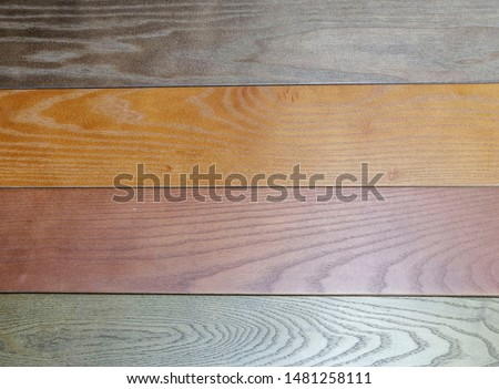 Wide Horizontal Image with Copy SpaceArt Wooden Background. Wood Surface Fence Panel with boards painted Multicolored Paint, Close-up. Wide Horizontal Image with Copy Space
