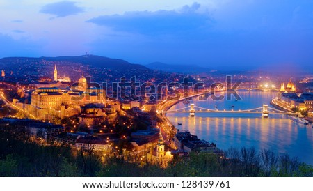 wide night view of Buda Castle and Chain Bridge on Danube River, Budapest