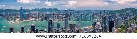 Wide panorama of Hong Kong skyline from Victoria Peak on a sunny day #716395264