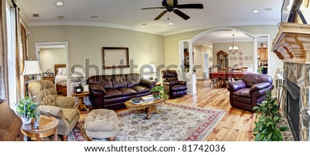 wide panorama of living area and dining area of upscale house