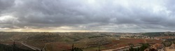 Wide panorama of Palestinian villages al'Alaqa al Fawqa and Rabud  before the storm in Judea at Har Hebron