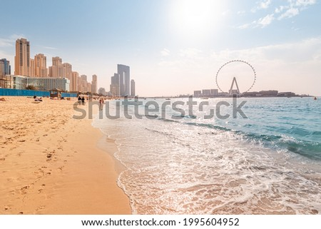 Wide panorama of the Persian Gulf with famous Ferris wheel Dubai Eye and numerous skyscrapers with hotels and residences. Travel and vacation destinations Photo stock ©