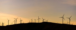 Wide panorama of Windmills silhouette at dusk in Palm Springs, California, U.S.A.
