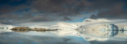 wide panorama with view to polar station on island and glacier in Antarctica