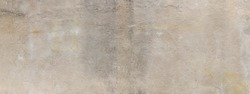 Wide panoramic background of concrete wall, grunge shades of tan and gray, creative copy space, horizontal aspect