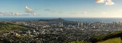 Wide panoramic image of sunset over Waikiki, Honolulu and Diamond Head from the Tantalus Overlook on Oahu, Hawaii