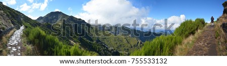 Wide panoramic view of Madeira island. Pathway with woman walking. 180 degree photography
