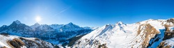 Wide panoramic view of winter landscape in Swiss Alps on the First mountain in Grindelwald, Switzerland