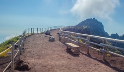 wide path is leading on the top of mount vesuvius volcano near italian naples and it offers great view of volcanos interior as well as of surrounding bay of naples.