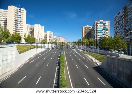 wide road with cars in madrid city