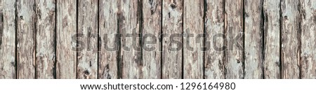 Wide rustic background. Rough wooden boards texture. Old knotty wood logs surface panorama