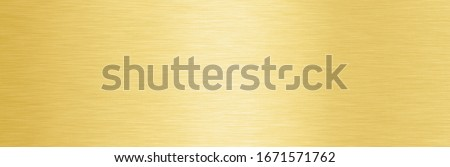 Wide Shiny smooth line metal gold color background Bright vintage Brass plate chrome panorama texture concept simple bronze foil panel hard backdrop design, panoramic golden light polished banner top