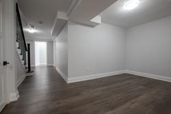 Wide shot of a finished basement