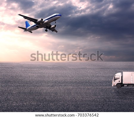 Wide skies and wide asphalt roads, and large planes and vans #703376542