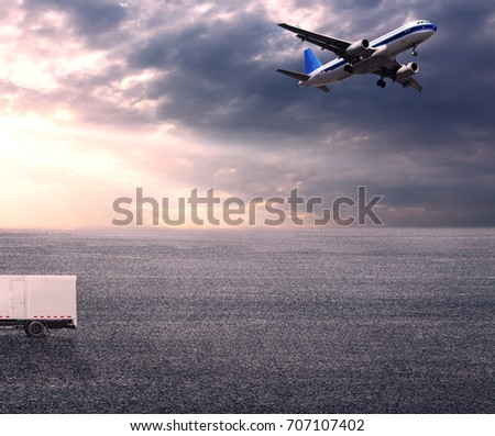 Wide skies and wide asphalt roads, and large planes and vans #707107402