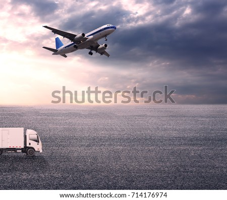 Wide skies and wide asphalt roads, and large planes and vans #714176974