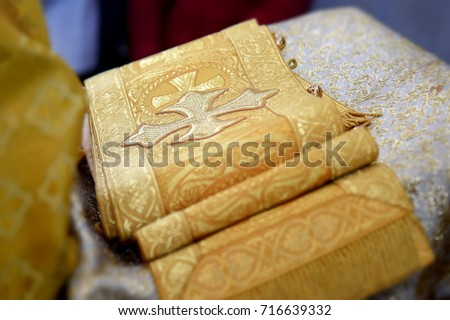 wide tape on the tray with the image of crosses , part of the vestments of Orthodox priests , which wears during worship - Shutterstock ID 716639332