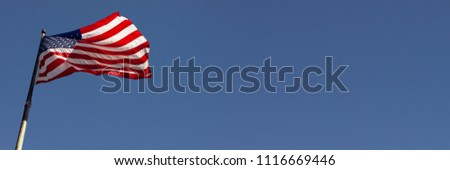 Wide USA Banner with waving American Flag on Blue Sky