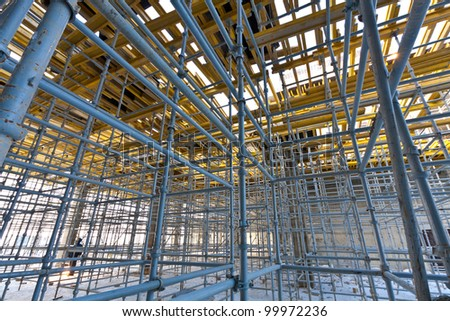 Wide view metalic scaffolding inside the building