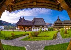 Wide view of Barsana Christian monastery house and garden in Maramures, Romania
