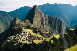 Wide view of Machu Picchu with hard sun light and bright colors