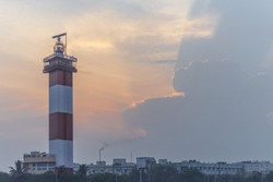 wide view of seascape with lighthouse seen beautiful color formation in the sky adds beauty to the photograph, chennai marina beach