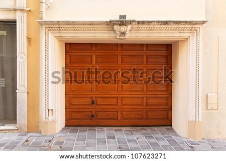 Wide wooden garage door at luxury home