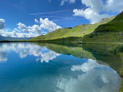 Wideangle view of schlossalmsee at badhofstein. Captured clear sunny day. Lake mirror sky