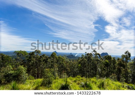 Wider view of some mountains of the Glass House Mountains National Park, from left to right Mount Beerwah, Mount Coonowrin, Mount Tibberoowuccum and Mount Tibrogargan #1433222678