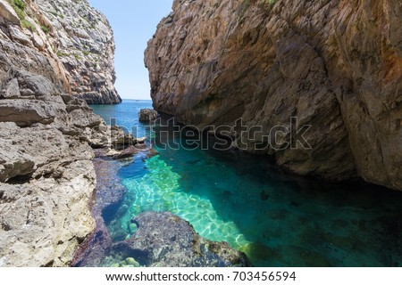 Wied Babu, at Wied iz-Zurrieq, azure blue turquoise waters at the bottom of the valley, next to the Blue Grotto, Zurrieq, Malta, May 2017