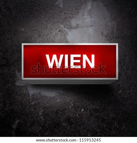 Wien light display. Vintage electric red light display over a dark, grunge background.