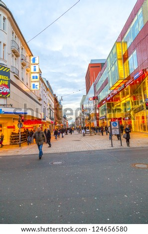 WIESBADEN, GERMANY - JAN 12: people shop in the pedestrian area on JAN 12,2013 in Wiesbaden, Germany. This central shopping zone offers a large variety of shops and stretches out for one kilometer..