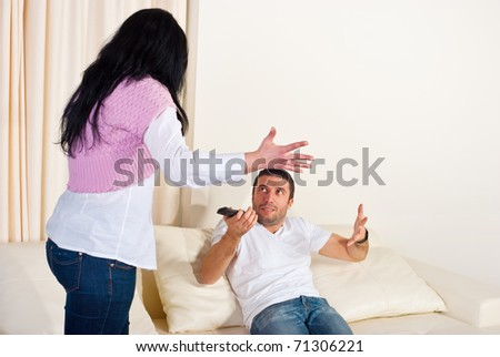 Wife and husband on couch having conflcit and arguing  home