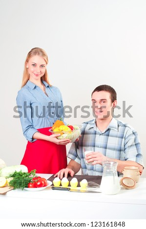 wife gives her husband a meal, have a nice time