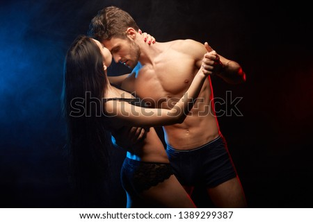 wife is dancing the tango with her husband and seducing him. close up photo #1389299387