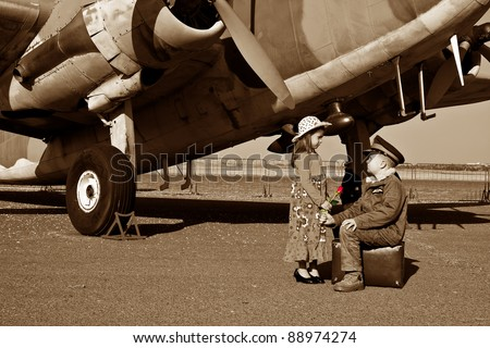 Wife saying good bye to pilot husband leaving for war