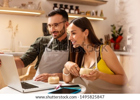 Wife smiling. Wife smiling while drinking coffee with husband and planning new seasonal menu #1495825847
