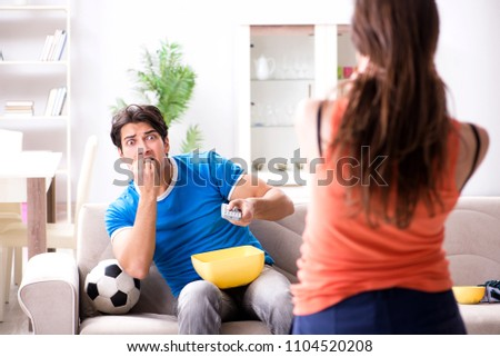 Wife unhappy that husband is watching football