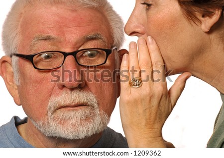 Wife whispers into husband ear