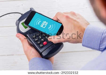 Wifi connection against man using smartphone to express pay #292332152